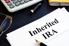 Inherited IRA documents on a table. Retirement plan. Inherited IRA documents on the table. Retirement plan royalty free stock photos