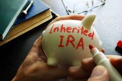 Inherited IRA. Inherited IRA written on a piggy bank Stock Photography