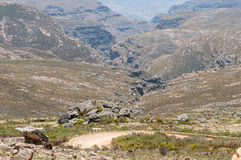 Inhospitable valleys of the arid Swartberg. (Black Mountain) as seen from the top of the pass. The pass is a declared national Stock Photography