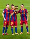 Iniesta, Messi e Xavi com esfera dourada Imagens de Stock Royalty Free