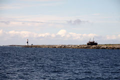 Inisheer, Aran islands. View of Inisheer island with lightouse and old abandoned ship, Aran islands Stock Image