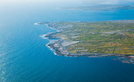 Inisheer and Inishmore. Aerial landscape of the lighthouse on Inisheer Island and Inishmore island, part of Aran Islands, Ireland Royalty Free Stock Photography