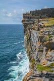Tourists on Dun Aengus cliffs, Inishmore, Aran Islands, Ireland. Inishmore, Aran Islands, Galway Bay, Ireland Royalty Free Stock Photos