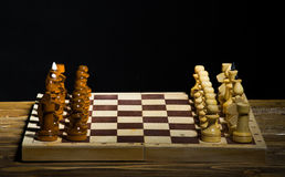 Initial chess position. On a black background Royalty Free Stock Photo