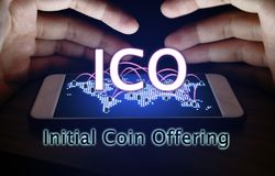 Initial coin offering and hand man protection smartphone with IC. O concept Royalty Free Stock Photos
