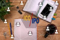 Initial coin offering ICO vs IPO Initial Public Offering on the. Touch screen to the network, on office background blur.Concept of IPO or ICO Royalty Free Stock Photo