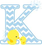 Initial k with bubbles and cute baby rubber duck. Initial k with bubbles and little baby rubber duck isolated on white background. can be used for baby boy birth Royalty Free Stock Image