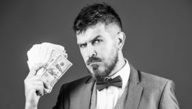 The initial loan. Business startup loan. Bearded man holding cash money. Rich businessman with us dollars banknotes. Currency broker with bundle of money royalty free stock images