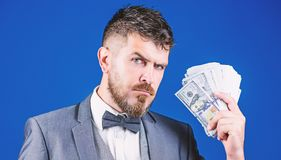 The initial loan. Business startup loan. Bearded man holding cash money. Rich businessman with us dollars banknotes. Currency broker with bundle of money royalty free stock photos