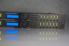 Initializing audio DSP front panel. Audio DSP front panel turned on with all leds on. With natural reflection. LCD display turned on. Device is initializing royalty free stock image