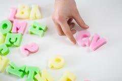 Initials of curriculum vitae. Close-up of plastic colorful initials of curriculum vitae stock images