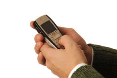 Initiating a Call. Male Hands Dialing Cell Phone Royalty Free Stock Photos