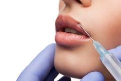 Injeção cosmética do botox à cara bonita da mulher Fotos de Stock Royalty Free