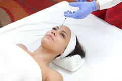 Injectable Filler. Woman Having Forehead Injection Filler Treatment at Beauty Clinic royalty free stock images