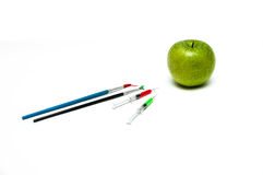 Unnatural injected apple. Injected apple looks like unnatural, painted Royalty Free Stock Photography