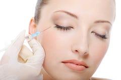 Injectie in het oog stock fotografie