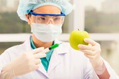 Injecting apple Stock Photo