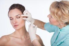 Injecting Botox On Isolated White Background Royalty Free Stock Photography