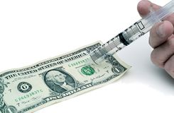 Injecting the dollar. Concept of injecting life into the dollar or economy royalty free stock image
