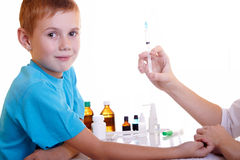 Injection. A doctor giving a child an injection Royalty Free Stock Photography