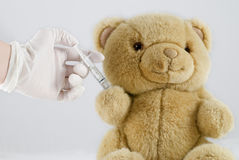 Injection. A sick teddy bear need an injection to get well Stock Image