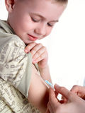 The injection. A doctor giving a child an injection Stock Photos