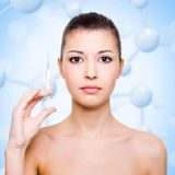 Injection of botox in beautiful woman face. Over molecule background stock photos