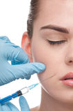 Injection of botox to the face of beautiful woman royalty free stock images