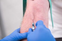 Injection of a catheter in the arm. Of a patient Stock Photos