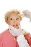 Injection cosmétique - lignes de froncement des sourcils Images stock
