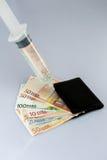 Injection d'argent liquide Photo libre de droits