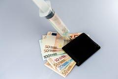 Injection d'argent liquide Photos libres de droits