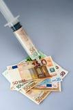 Injection d'argent liquide Images libres de droits