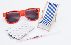 Injection and deck chair Royalty Free Stock Photo