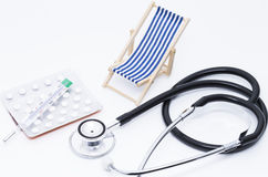 Injection and deck chair Royalty Free Stock Photos