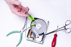 Injection dedans à l'unité de disque dur Image libre de droits