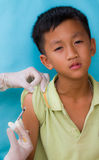 Injection. Doctor injecting to a boy Stock Images