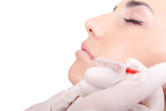 Injection into female lips Royalty Free Stock Photo