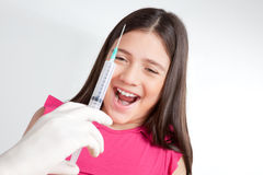 Injection in Front of Girl Royalty Free Stock Photography