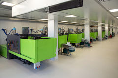 Injection molding of biomedical products in clean room. Injection molding (or moulding) of biomedical products in a large cleanroom. A cleanroom or clean room is stock photos