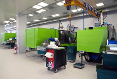 Injection molding of biomedical products in clean room Royalty Free Stock Photos