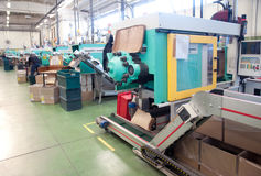 Injection molding machines in a large factory Stock Images