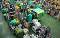 Injection molding machines in a large factory royalty free stock photos