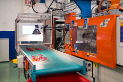 Injection molding machines in a large factory Royalty Free Stock Photo