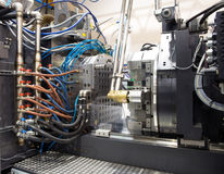 Injection molding machines in a large factory Royalty Free Stock Photography