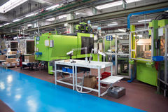 Injection molding machines in a large factory Stock Photography