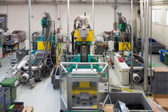 Injection molding machines in a large factory Stock Photo