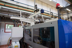 Injection molding machines in a large factory Royalty Free Stock Images