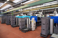 Injection molding machines in a large factory Royalty Free Stock Image