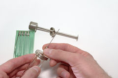 Injection needle`s manual setting on reusable medical syringe Royalty Free Stock Photo